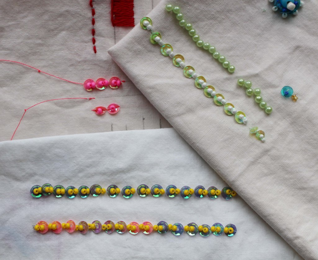 sequin-rows-beads-yellow-white-embroidery-technique-on-white-cloth